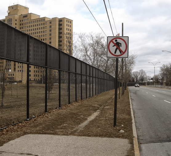 On Union Turnpike near Creedmoor Psychiatric Center, the sidewalk ends but the dirt path shows pedestrians still walk along the road. Photo: Angus Grieve Smith