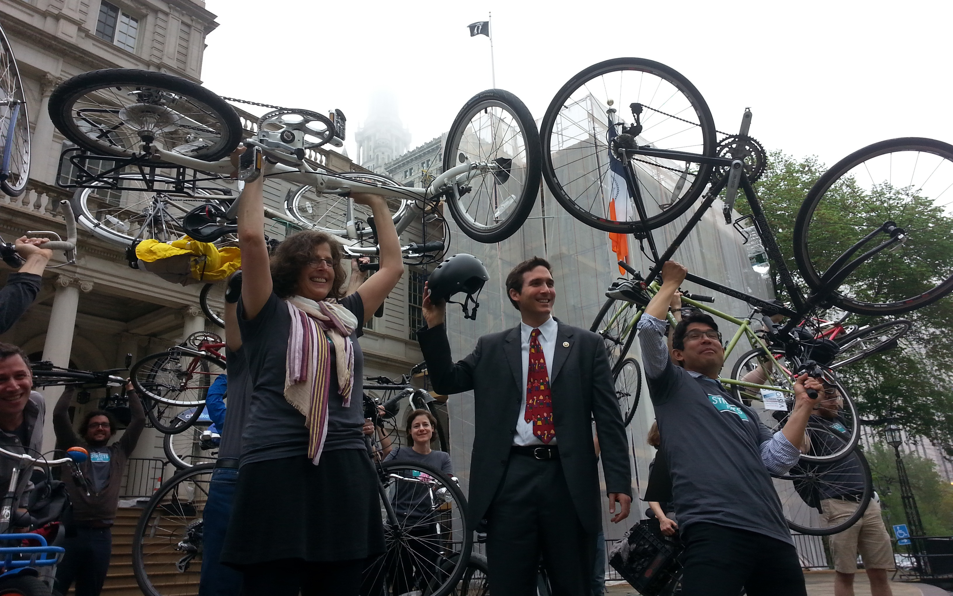 Council Members Helen Rosenthal, Ben Kallos, and Carlos Menchaca raise their bicycles outside outside of City Hall this morning. Photo: Stephen Miller