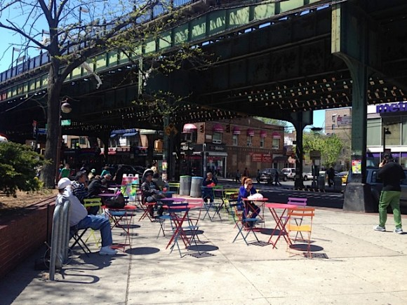 Manuel de Dios Unanue Triangle at Roosevelt Avenue and 83rd Street has received a seating upgrade. Photo: Clarence Eckerson Jr.