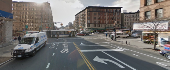 St. Nicholas Avenue at 145th Street, where a cyclist says she was nearly struck, and then harassed, by two NYPD officers in a marked patrol car. Image: Google Maps