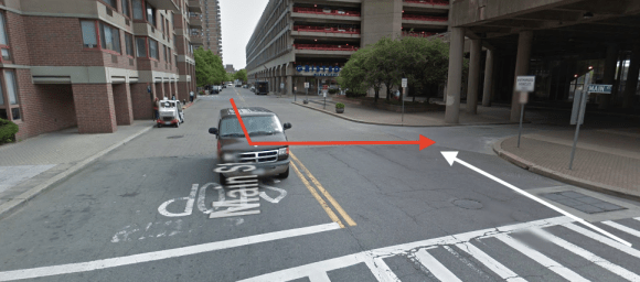 The bus driver was making a turn, in red, when he struck cyclist Anna Maria Moström, whose path is shown in white. NYPD's preliminary investigation results fault the driver, but no charges have been filed. Photo: Google Maps