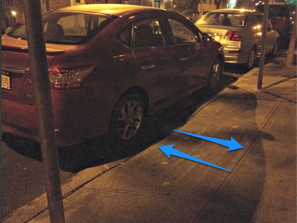 motorist with nyc disability placard blocks curb ramp with car