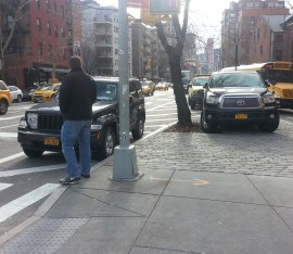 Not everything is fixed at the intersection. Fire Department employees continue to abuse pedestrian space for personal parking. Photo: Stephen Miller