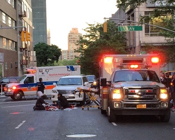 Paramedics work to save John Torson a few feet from the crosswalk at E. 61st Street and First Avenue. Photo: Daniel S. Dunnam