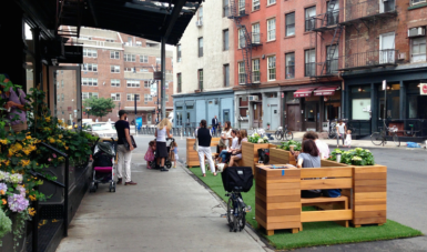 TA suggests placing new vendor carts in the curb lane as part of an expanded Street Seats program. Photo: NYC DOT