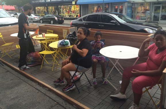The Street Seat on Pitkin Avenue isn't even complete yet, but residents are already using it. Photo: Stephen Miller