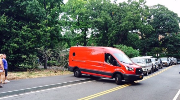A van driver attempts to turn around, using a Prospect Park sidewalk. Photo: Stanley Greenberg