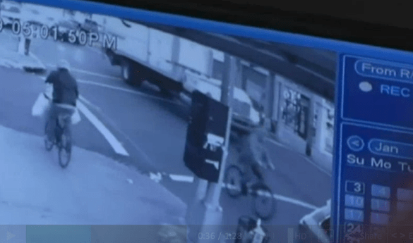 A video shows Can Reng Ma cycling on Avenue U as the truck driver suspected of killing him approaches from behind. Image: WNBC