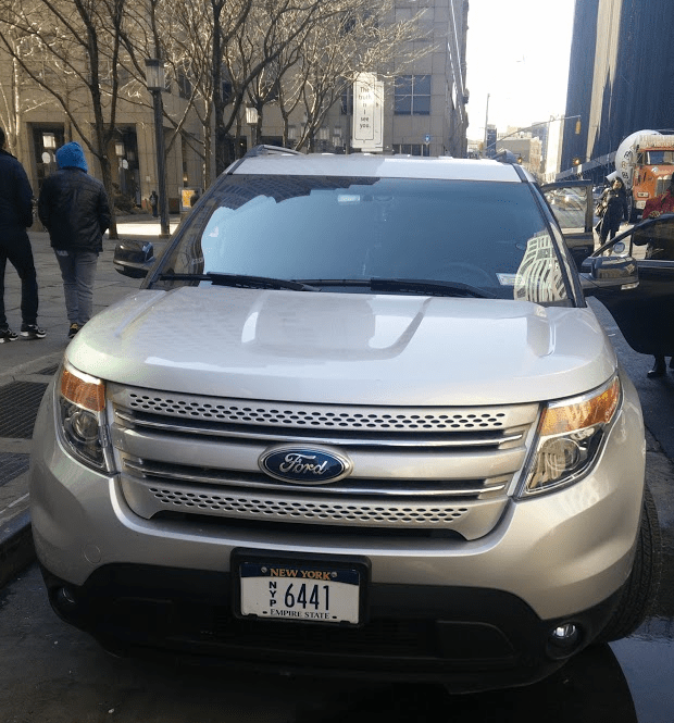 A car with state-issued press license plates parked illegally on Jay Street in Downtown Brooklyn. Photo: David Meyer