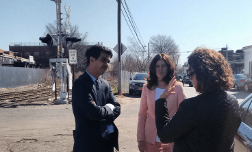 Council Transportation Chair Ydanis Rodriguez, left, and Council Member Elizabeth Crowley, center, discuss transit concerns on a tour of transit-strapped central Queens. Photo: David Meyer