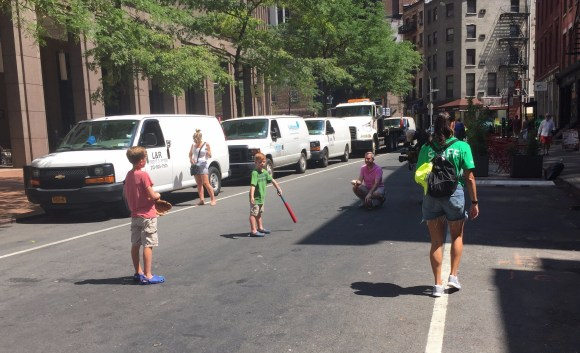 """A new sight in old New York: Children playing ball in the street during DOT's """"Shared Streets"""" event on Saturday."""