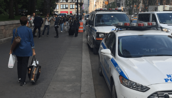 These NYPD vehicles are already parked in a bike lane. Let's hope they're gone when that lane gets protected in the coming weeks. Photo: David Meyer