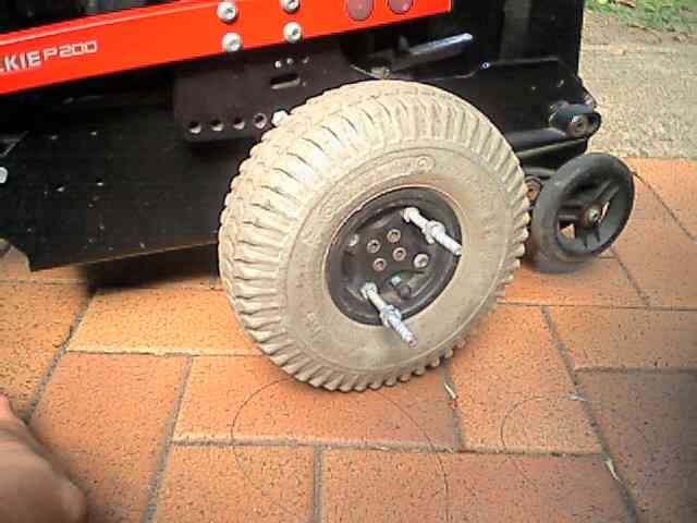 Replace wheel studs with long bolts