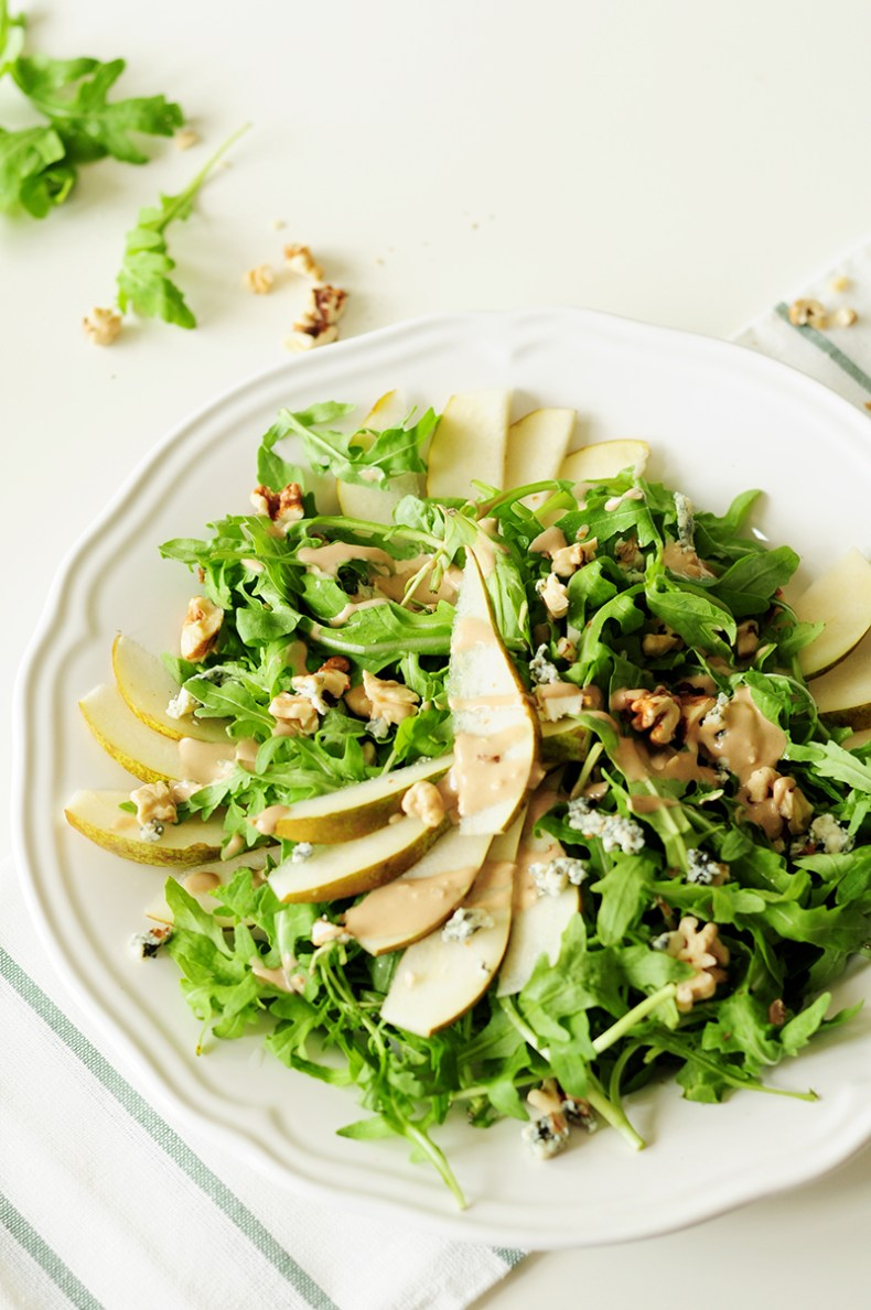 Topped with blue cheese and chopped walnuts, this four-ingredient arugula pear salad drizzled with tahini dressing is so quick to throw together, yet the combination of sweet and salty flavors and crunchy and soft textures proves that simple can be phenomenal.