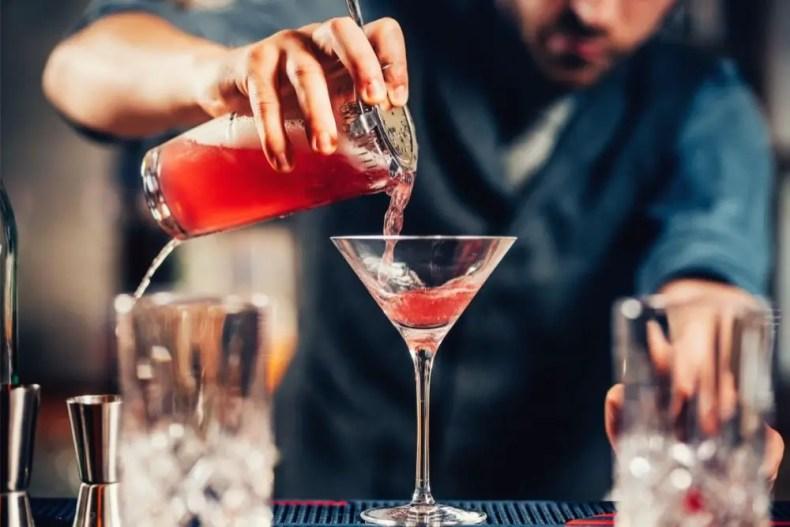 Bartender making cocktail with vodka