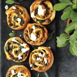 Well-seasoned ground beef, spinach, mushrooms, and cheese rolled up into a pizza dough, these savory sticky buns are served with a cream cheese frosting, making them extra yummy!