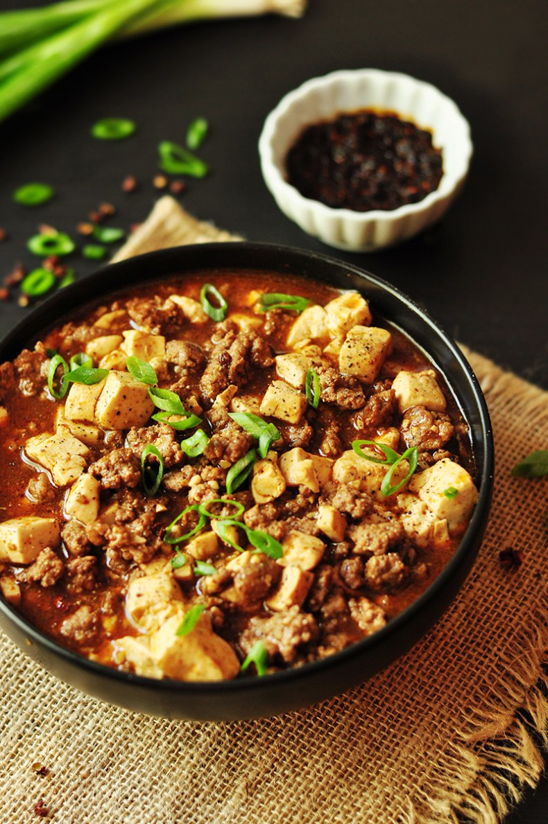 Traditional Chinese comfort food Mapo Tofu made easy. This gluten-free dish is made with 5-min home-made hot chili oil and pepper solids and simmered in beef broth or a hearty home-made bone broth. It's healthy and rich in flavor. Pair it with rice to complete your legit 30-min Chinese meal.
