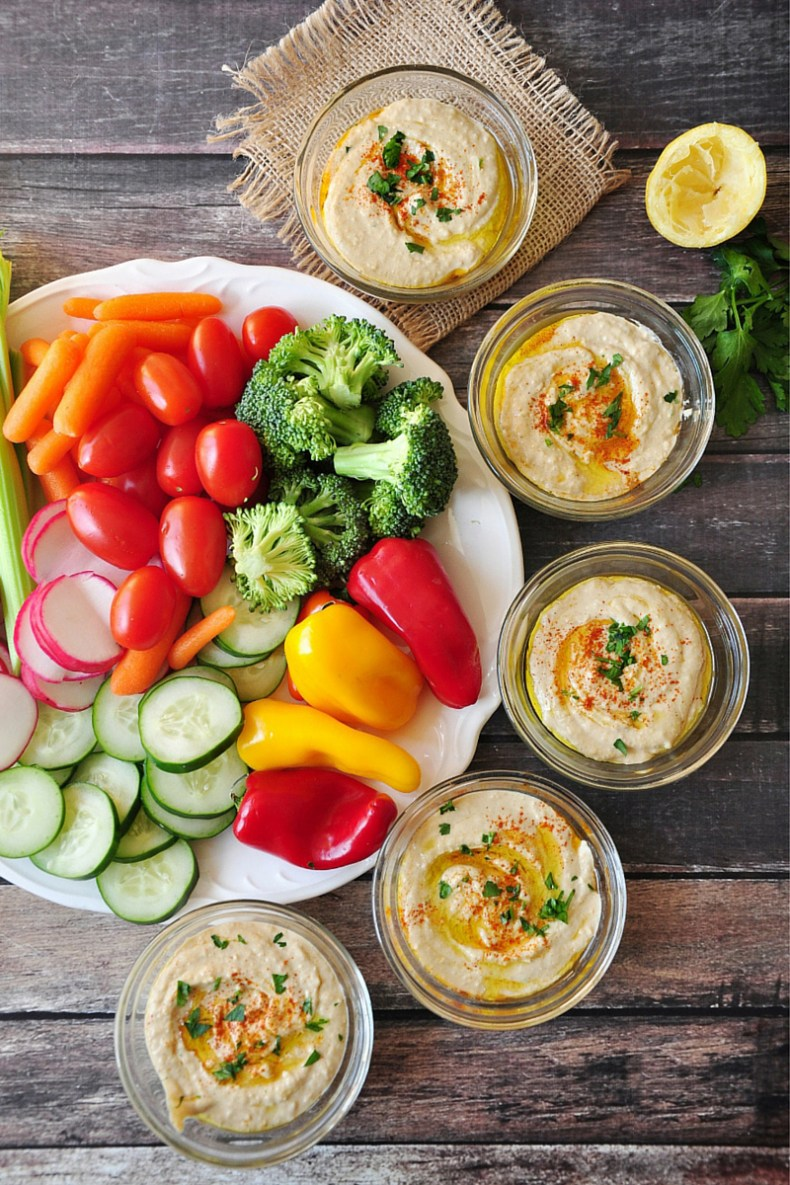 If you haven't tried hummus before, you owe it to yourself to try this Middle Eastern food that has made its way onto tables around the world. It's a smooth and creamy spread that is healthful and versatile, and so easy to make at home.