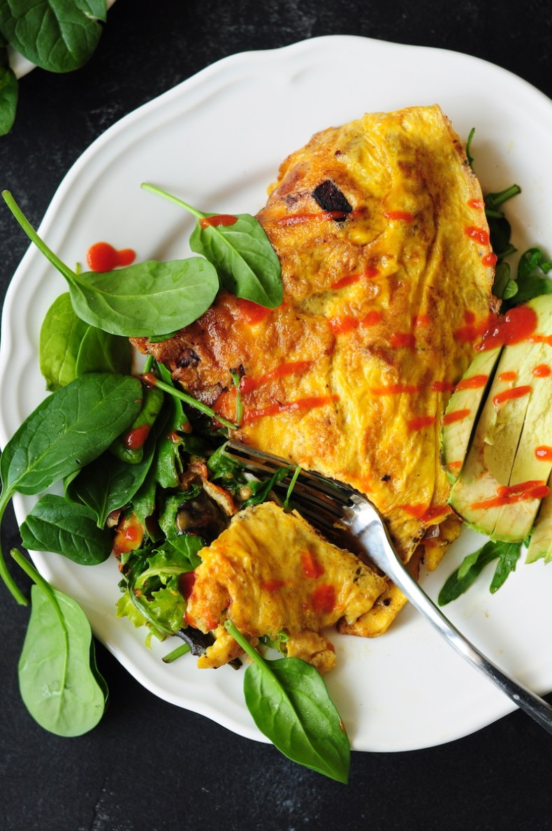 Start your day right with this gluten-free breakfast omelette! It's loaded w/ vegetables, cheese, & your preferred meat. It's super healthy & delish.
