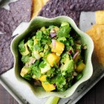 Refreshingly tasty mango avocado salsa that's a crowd-pleasing snack or appetizer with tortilla chips and it's amazing as a topping for seafood.