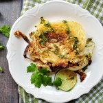Cabbage steaks seared and roasted to perfection with a refreshing lime and cilantro sauce to boost the flavor.