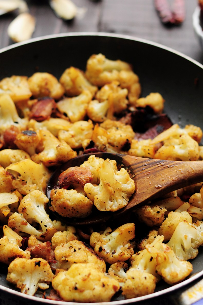 An easy recipe with only 7 ingredients like this sautéed cauliflower with bacon is perfect for any busy workday dinner. It's a little spicy, gluten-free and so delicious that you won't want to stop digging in.