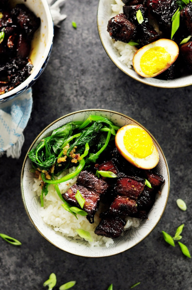 Authentic Shanghai-style braised pork belly simmered in rich and dark soy sauce and Chinese cooking wine, caramelized with brown sugar along with fresh ginger, garlic, green onion, and star anise. This is a true Chinese dish you can make in your own kitchen.