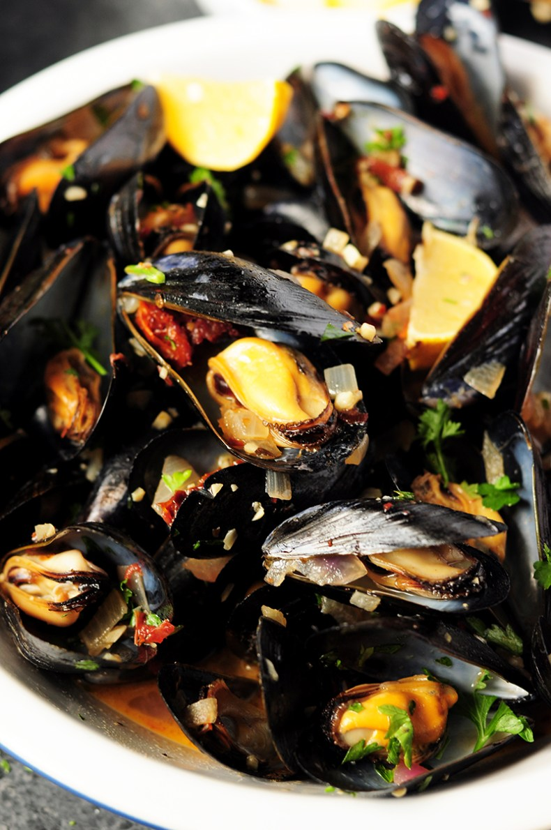 Super easy mussel recipe steamed in white wine and flavor-rich chicken bone broth. Serve it as an amazing appetizer or over spaghettias an elegant dinner.