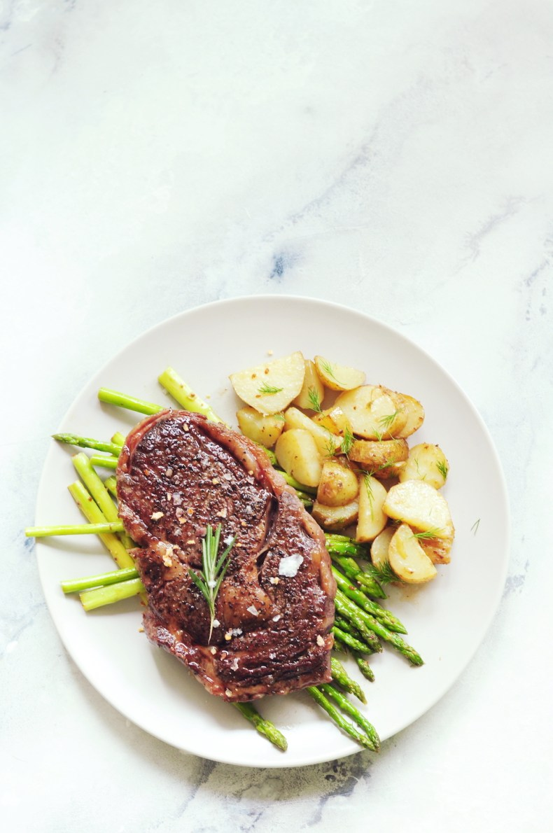 sous vide frozen steak with potatoes and asparagus