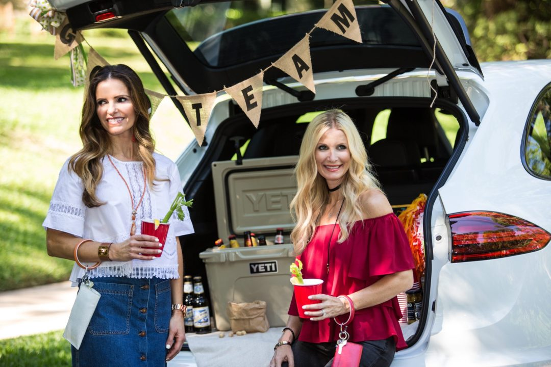 College Game Day Attire/Tiffany Davros/ Dallas Fashion Blogger/ Jonathan Simkhai Embroidered Top/ O. Venture Big O Card Case/Big O Key Ring/ Prada suede mules / Denim button down skirt/ Street Edit