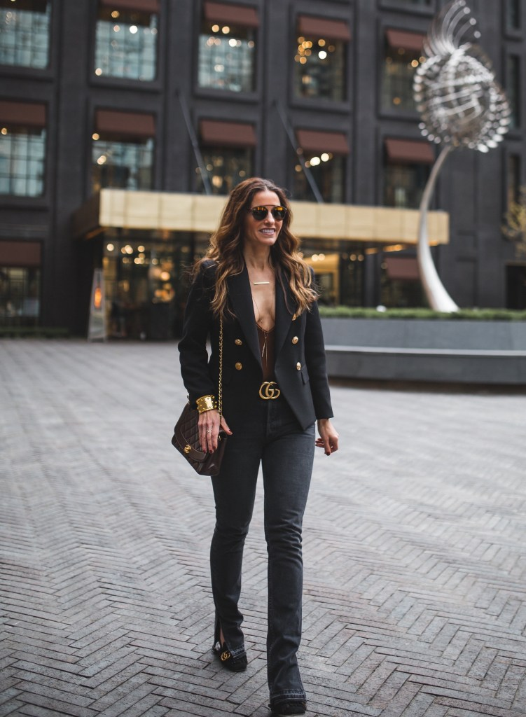 Take Your Look To The Next Level With One Item: A Balmain Blazer Dupe//Dallas Fashion Blogger// Tiffany Davros// Tahari Double Breasted Blazer//GRLFRND Natalie Split Hem Jeans//Blue Life Suede Body Suit// Alexis Bittar Spike necklace// Jennifer Zeuner horizontal necklace//Harper Hallam Bracelet// Gucci logo belt//Gucci Suede Loafer//Chanel vintage handbag// Dior so real two tone brow bar sunglasses