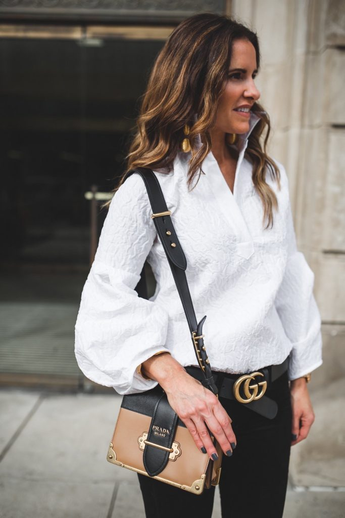 Dressy Or Casual Valentine Looks For All// Dallas Fashion Blogger/ /Tiffany Davros// Tish Cox Blouse// Rag & Bone Skinny Velvet Jean// Prada cahier notebook shoulder bag// Christian Louboutin Black Pump// Gucci logo belt// Rebecca de Ravenel bonbon earrings