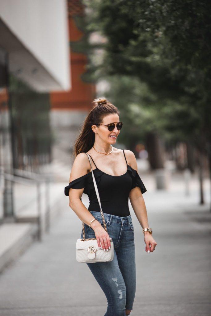LPA Black Bodysuit | Mother Stunner Ripped Jeans | Gucci Handbag | Dior Sunglasses | Eddie Borgo Gold Choker Necklace