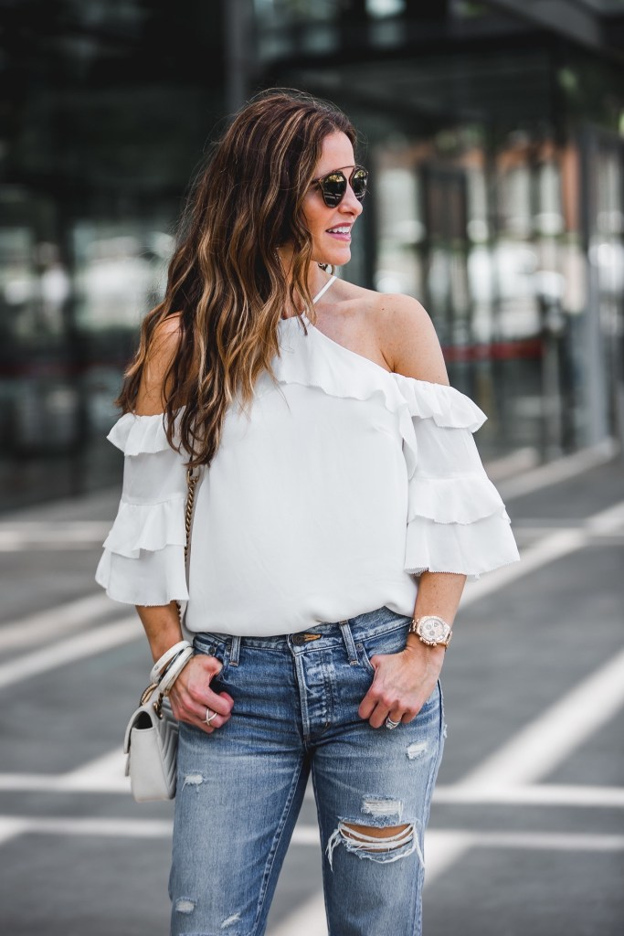 Parker Natalia Ruffled Cold-Shoulder Silk Blouse || MOUSSY MV Bowie Tapered Jeans || Gucci GG Marmont Matelassé Shoulder Bag || Dior So Real Round Brow Bar Sunglasses || Nicola Bathie Designs Bracelets