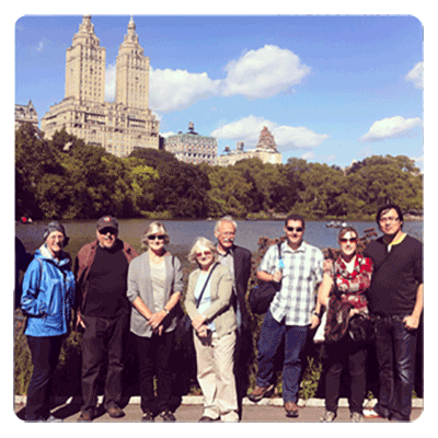 tour group in Central Park in front of the San Remo