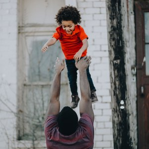 A father throwing his son into the air