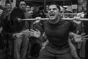 Marine Corps lightweight powerlifter completes a squat.