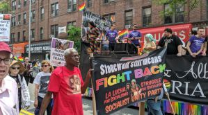 Queens Pride marchers demand freedom for migrants, Chelsea Manning
