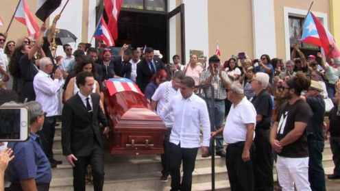 Don Rafa's son, Rafael Cancel Vazquez, (right in front in white guayabera) helps carry his father's coffin.