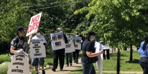 County workers picket anti-union politician