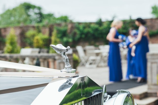 bridesmaids and wedding car