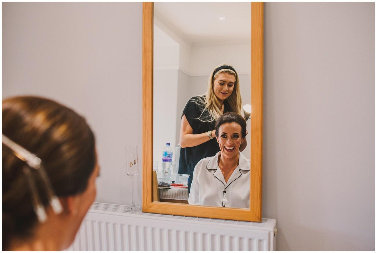 bride smiling in the mirror