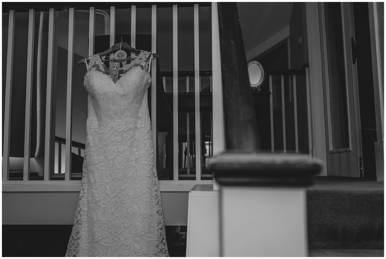 wedding dress hanging from stairs