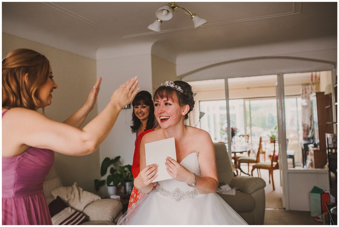 bride laughing at card