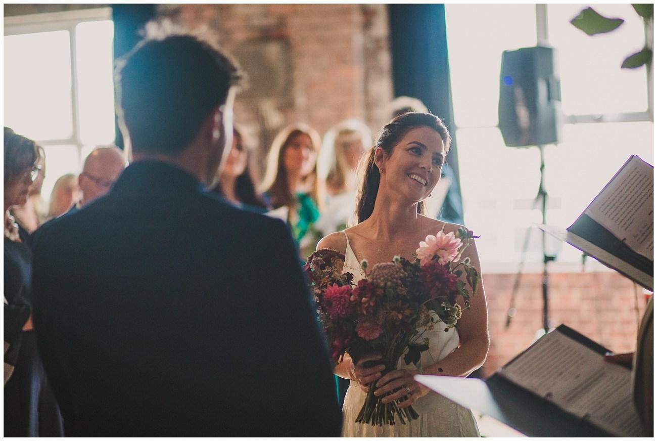 bride smiling at celebrants