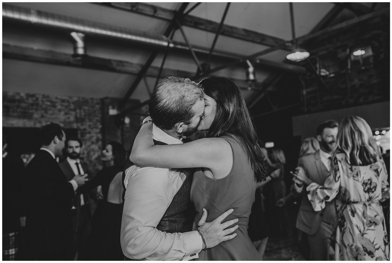 wedding guests sneakily kissing