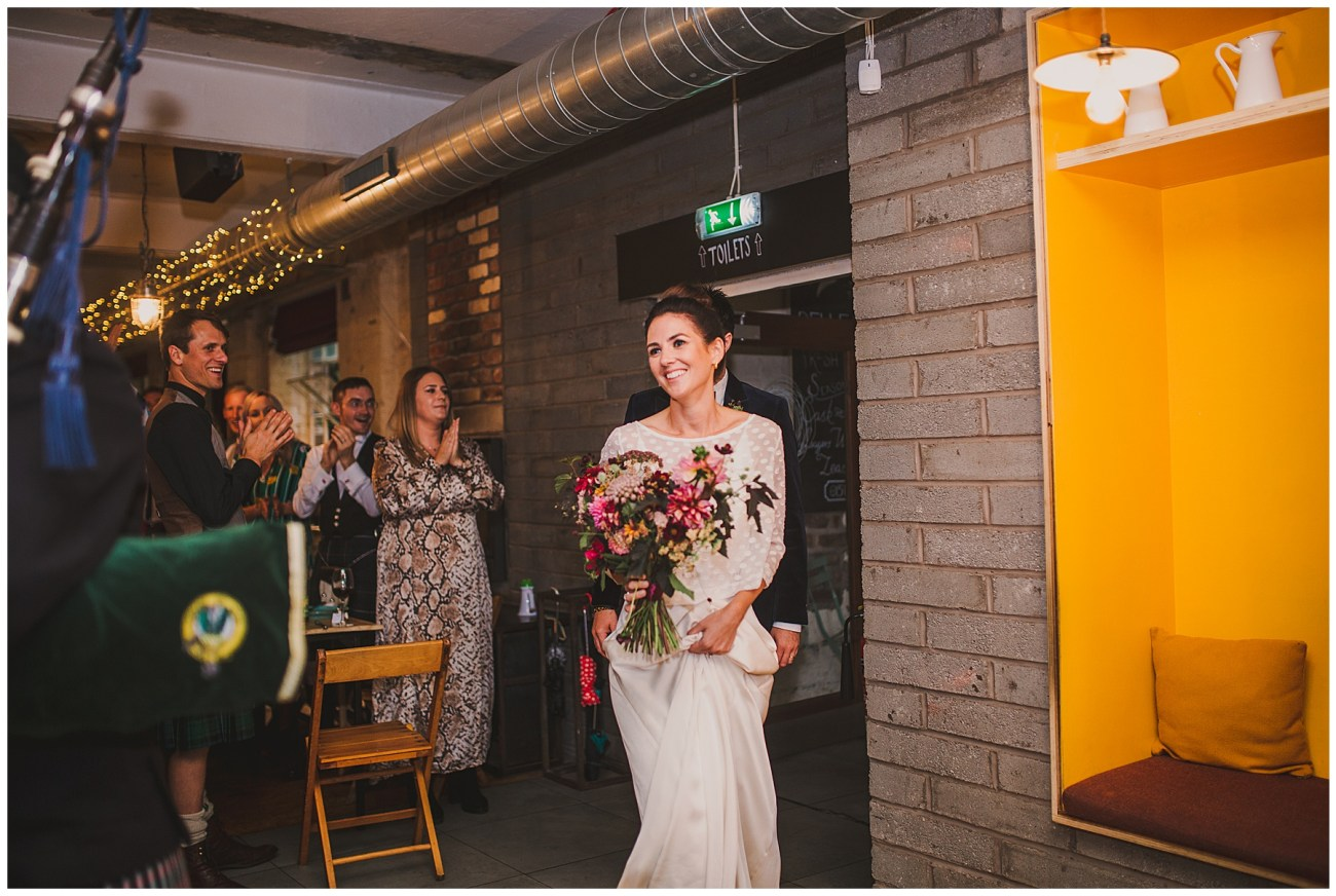 bride smiling entering venue