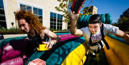 Students Michael Gaytko (left) and J.J. Marvin compete in an inflatable race.