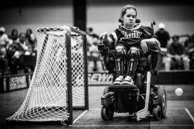 Goaltender Sarah Heinsch blocks a shot during the Minnesota Saints PowerHockey Cup Championship game.