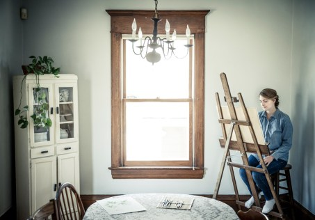 Student Anna Rosenthal paint botanical art in her St. Paul home.